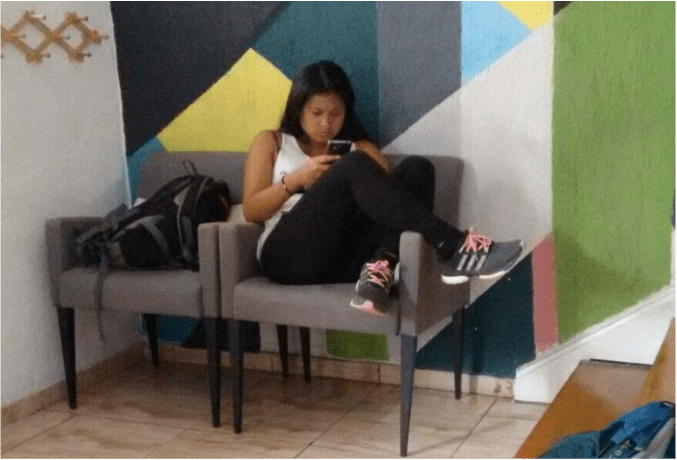 Shyrwyn checking her phone in Brazil