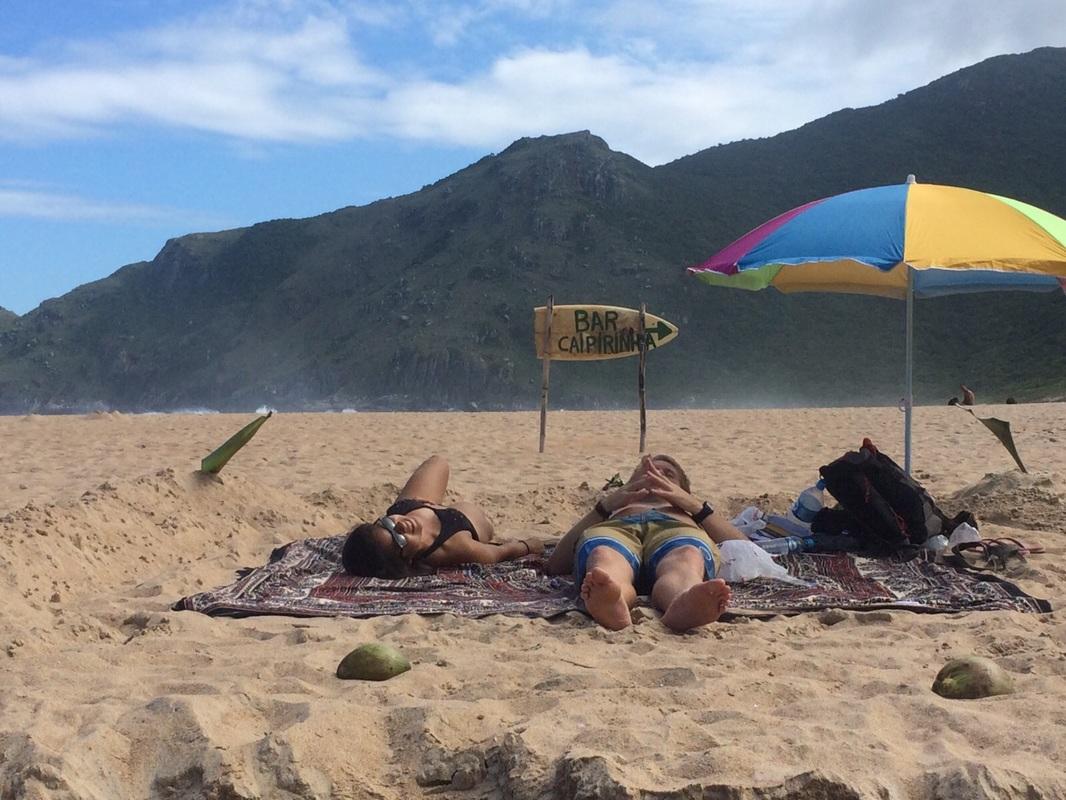 Shyrwyn enjoying the beach after hiking barefoot in Florianópolis, Brazil